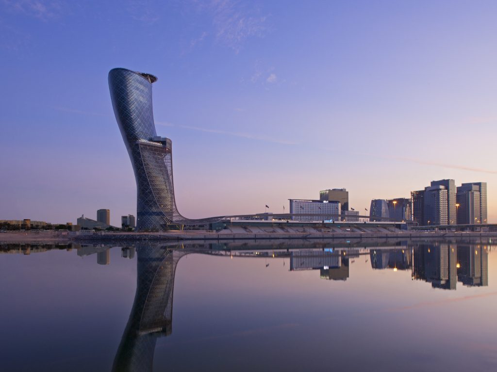 The blue Capital Gate Building reflects the sun off of its slanted exterior in Abu Dhabi, UAE