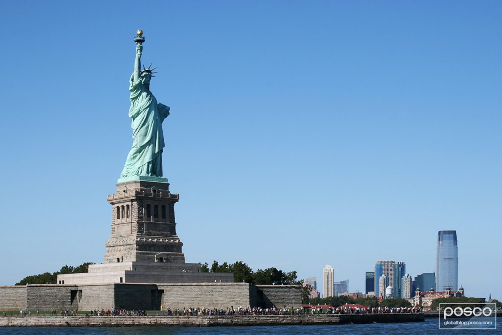The Statue of Liberty against a clear blue sky