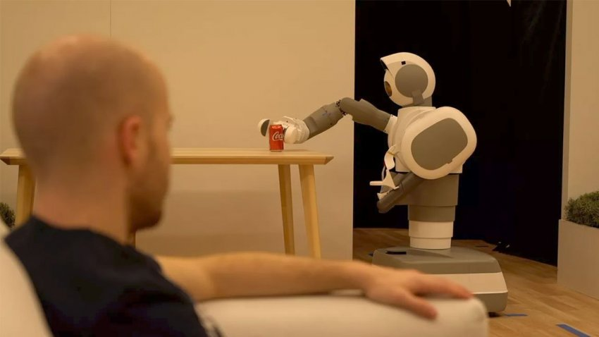 An Aeolus Bot grabbing a can of coke for a person.