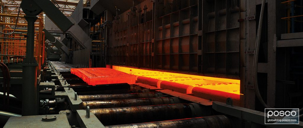 Red hot molten steel getting rolled.