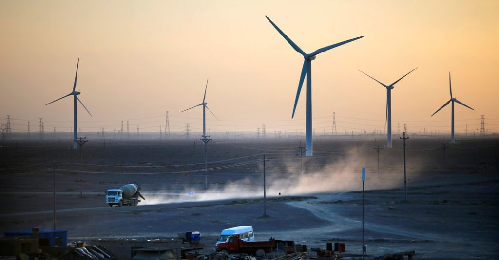 The Jiuquan Wind Power Base in China at sunset.
