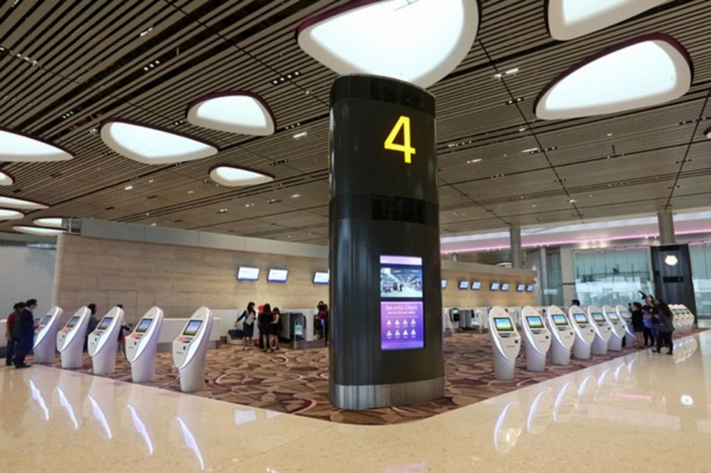 Changi Airport Terminal 4 with self-service kiosks.