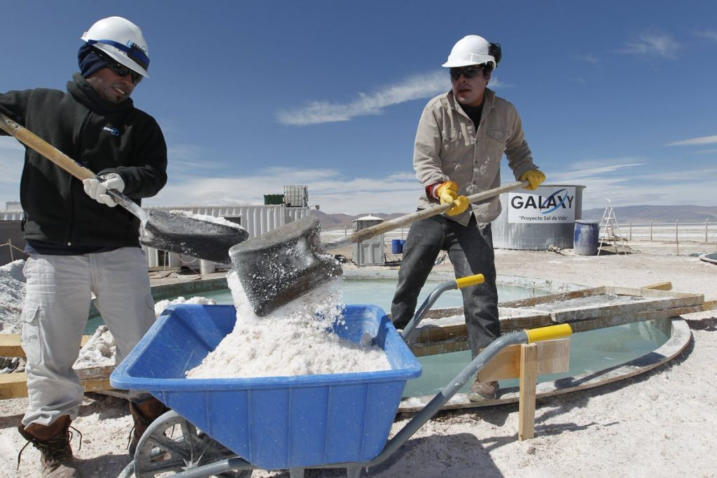 Two South American Miners working at a lithium mine.
